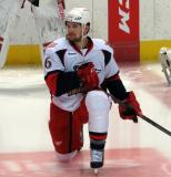 Xavier Ouellet stretches in the neutral zone during pregame warmups before a Grand Rapids Griffins game.