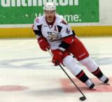Brennan Evans skates in the neutral zone during pregame warmups before a Grand Rapids Griffins game.