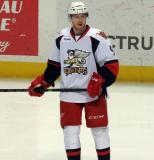 Mark Zengerle stands near the boards during pregame warmups before a Grand Rapids Griffins game.