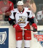 Marek Tvrdon stands at the boards during pregame warmups before a Grand Rapids Griffins game.