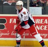 Andreas Athanasiou stands at the boards during pregame warmups before a Grand Rapids Griffins game.