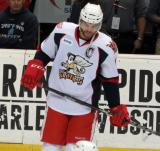 Jeff Hoggan skates near the bench during pregame warmups before a Grand Rapids Griffins game.