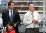 Assistant coaches Mike Knuble and Pat Ferschweiler stand behind the bench during pregame warmups before a Grand Rapids Griffins game.