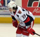 Tyler Bertuzzi crouches near the boards during pregame warmups before a Grand Rapids Griffins game.