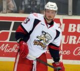 Marek Tvrdon skates near the boards during pregame warmups before a Grand Rapids Griffins game.