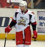Marek Tvrdon stands near the boards during pregame warmups before a Grand Rapids Griffins game.