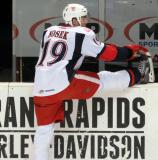 Tomas Nosek stretches at the bench during pregame warmups before a Grand Rapids Griffins game.