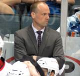 Head coach Jeff Blashill stands behind the bench during a Grand Rapids Griffins game.