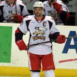 Jeff Hoggan skates near the bench during a stop in play in a Grand Rapids Griffins game.