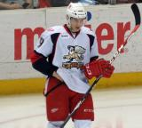 Tomas Nosek adjusts his equipment during a stop in play in a Grand Rapids Griffins game.