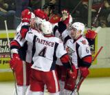 Brennan Evans, Nathan Paetsch, Jeff Hoggan, Tomas Nosek, and Teemu Pulkkinen celebrate a goal by Hoggan during a Grand Rapids Griffins game.