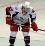 Tyler Bertuzzi lines up at wing for a faceoff during a Grand Rapids Griffins game.