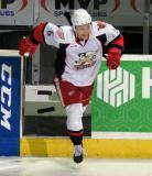Teemu Pulkkinen jumps onto the ice after being announced as the second star of a Grand Rapids Griffins game.