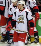 Zach Nastasiuk stands near a group of players during pre-game warmups before a Grand Rapids Griffins game.