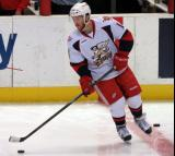 Nick Jensen skates with the puck during pre-game warmups before a Grand Rapids Griffins game.