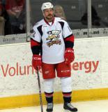 Kevin Porter stands at the end boards during pre-game warmups before a Grand Rapids Griffins game.