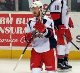 Brennan Evans skates near the boards during pre-game warmups before a Grand Rapids Griffins game.