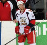 Nick Jensen stands at the bench during pre-game warmups before a Grand Rapids Griffins game.