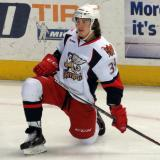 Tyler Bertuzzi stretches near the boards during pre-game warmups before a Grand Rapids Griffins game.