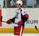 Zach Nastasiuk stands on the ice during pre-game warmups before a Grand Rapids Griffins game.
