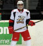 Andreas Athanasiou stands at the boards during pre-game warmups before a Grand Rapids Griffins game.