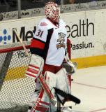 Jared Coreau stands in his crease during pre-game warmups before a Grand Rapids Griffins game.