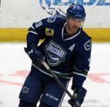 Former Red Wing Kent Huskins of the Utica Comets skates during pre-game warmups before a game against the Grand Rapids Griffins.