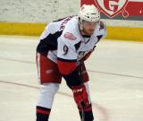 Mark Zengerle gets set for a faceoff during a Grand Rapids Griffins game.