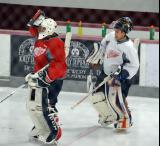 Joren van Pottelberghe and Tomas Kral skate back to the crease after a break in goalie drills at the Red Wings' 2015 Development Camp.