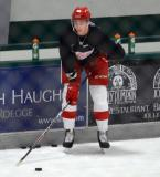 Jarret Meyer stands near the boards during a drill at the Red Wings' 2015 Development Camp.