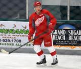 Jin-Hui Ahn stands near the boards during a drill at the Red Wings' 2015 Development Camp.