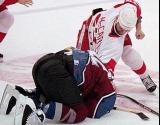 Claude Lemieux turtles as Darren McCarty pummels him.