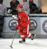 Dominic Turgeon skates with the puck during warmups before a scrimmage at the Red Wings' 2015 Development Camp.