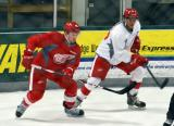 Michael Babcock and Jalen Chatfield jump in on a faceoff during a scrimmage at the Red Wings' 2015 Development Camp.