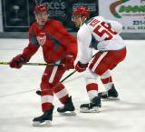Zach Nastasiuk shadows Mike McKee during a scrimmage at the Red Wings' 2015 Development Camp.