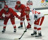 Bryce Gervais, Kevin Lidstrom, and Evgeny Svechnikov line up for a faceoff during a scrimmage at the Red Wings' 2015 Development Camp.