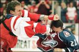 Darren McCarty punches Claude Lemieux in the head.