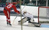 """Joren van Pottleberghe stretches out to stop Hampus Melen's """"Forsberg Move"""" shootout attempt during a scrimmage at the Red Wings' 2015 Development Camp."""
