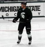Jared Nightingale stands on the ice during a session at the 2015 MSU Pro Camp.