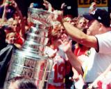 Retiring Red Wings coach Scotty Bowman carries the Stanley Cup through the parade celebrating their 2002 Stanley Cup Championship.