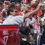 Chris Chelios waves to the crowd during the parade celebrating the Red Wings' 2002 Stanley Cup Championship.