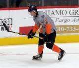 Bryce Yetman skates during pre-game warmups before a Flint Firebirds game.