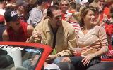 Mathieu Dandenault waves to fans during the parade honoring the Red Wings' 2002 Stanley Cup Championship.