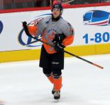 Vili Saarijarvi checks his stick during pre-game warmups before a Flint Firebirds game.
