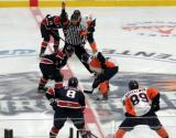 The opening faceoff of the Flint Firebirds' inaugural home opener, with Will Bitten, Connor Chatham and Zach Grzelewski of Flint facing off against Brady Gilmour, Connor Brown and Artem Artemov of the Saginaw Spirit.