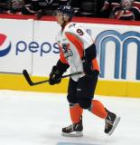 Vili Saarijarvi skates near the benches during a Flint Firebirds game.