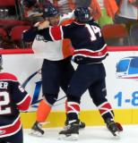 Francesco Vilardi of the Flint Firebirds and Devon Paliani of the Saginaw Spirit tangle along the boards.