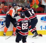 Francesco Vilardi of the Flint Firebirds tangles with Devon Paliani of the Saginaw Spirit.