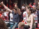 "Pavel Datsyuk gives fans the ""thumbs-up"" sign during the parade honoring the Red Wings' 2002 Stanley Cup Championship."