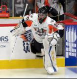 Zack Bowman leads the Flint Firebirds onto the ice for the start of the third period.